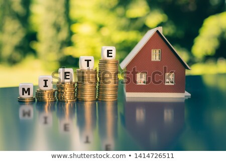 Coin stacks with letter dice - Rent Stock photo © Zerbor