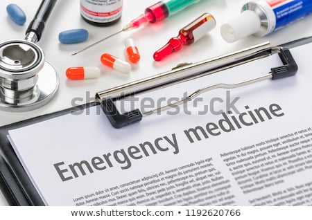 the text emergency medicine written on a clipboard stock photo © zerbor