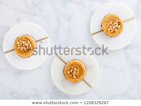 Stock photo: Homemade biscuit cookies with almond nuts and peanut butter on marble coasters on white kitchen tabl