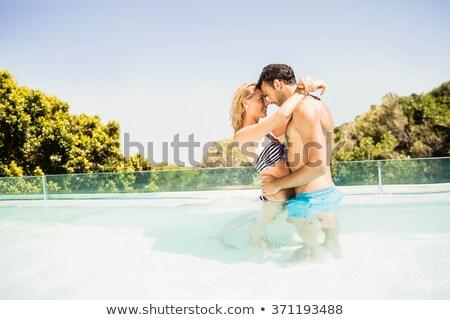 mooie · jonge · vrouw · permanente · zwembad · badjas · vrouw - stockfoto © boggy