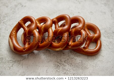 Stock photo: Row of fresh baked brown salty pretzel bread