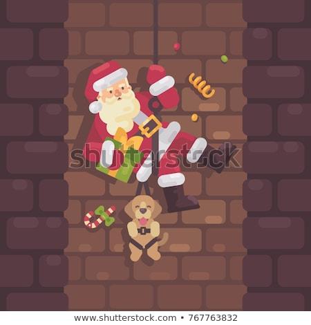 Noel baba aşağı baca köpek sunmak el Stok fotoğraf © IvanDubovik