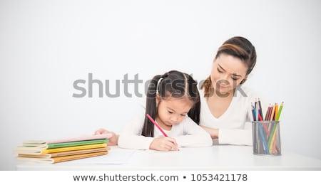 mãe · filha · casa · mamãe · little · girl · lição · de · casa - foto stock © Lopolo