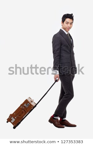 Businessman departs to a business trip with symbols Stock photo © ra2studio