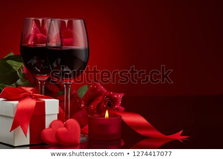 Valentines day romantic decoration with roses, wine glasses, boxed gifts, candles Stock photo © dash