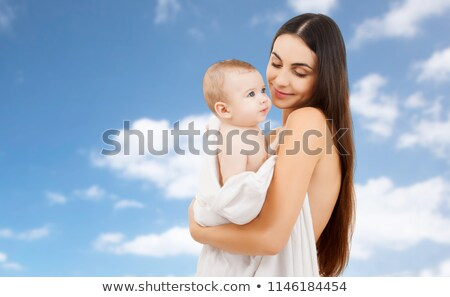 mother with baby in bath towel over sky background Stock photo © dolgachov