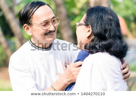 Sonriendo hombre sudar esposa servilleta Foto stock © Kzenon