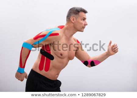 Shirtless Man With Physio Tape On His Body Stock photo © AndreyPopov