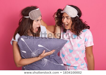 Two annoyed girls wearing pajamas standing Stock photo © deandrobot
