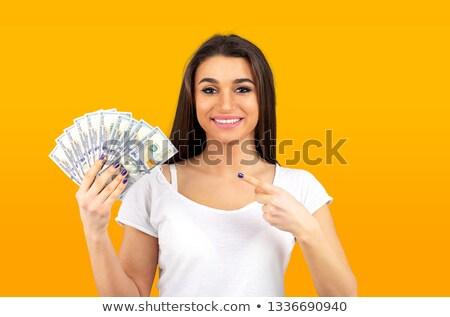 woman feeling super happy holding fan of dollar money Stock photo © ichiosea