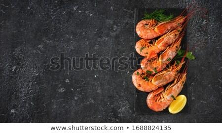 Grilled big tiger shrimps prawns on black slate plate Stock photo © Illia