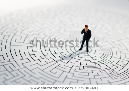 Small businessman in a middle of a maze Stockfoto © ra2studio