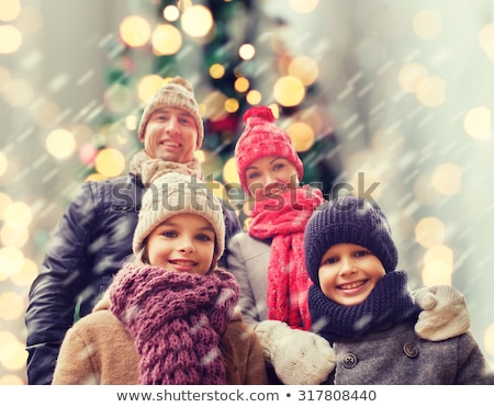 beautiful woman over christmas tree lights Stock photo © dolgachov
