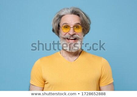 Volwassen man stijlvol zonnebril poseren studio kleurrijk Stockfoto © pressmaster