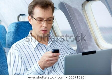 Férfi ír sms repülőgép közelkép személyek Stock fotó © AndreyPopov