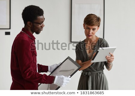 Waist up portrait of female business manager using digital tablet Stock photo © pressmaster