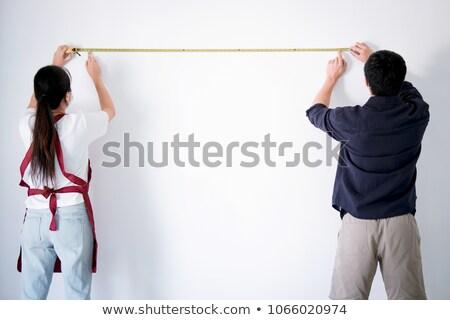 Interior trabalhando dois pintor fita métrica parede Foto stock © Freedomz