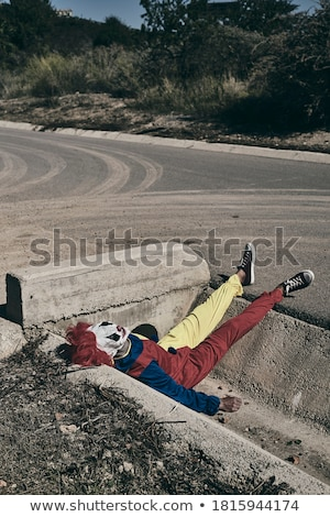 scary clown lying down outdoors Stock photo © nito