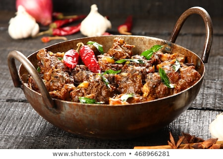 Indian cuisine-Famous Indian mutton or lamb curry dish in a cast iron cookware. Selective focus phot Stock photo © galitskaya