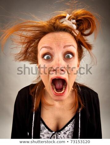 Zdziwiony krzyczeć gospodyni domowa portret dziwaczny dziewczyna Zdjęcia stock © nomadsoul1