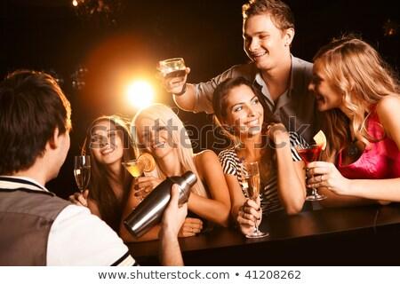 Gelukkig meisjes fluiten champagne jonge man Stockfoto © pressmaster