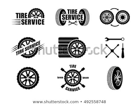 tyre shop logo with tyre and wrench Stock photo © djdarkflower