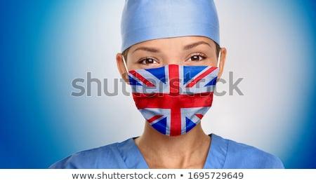 Flagge britisch Arzt Frau tragen medizinischen Stock foto © Maridav