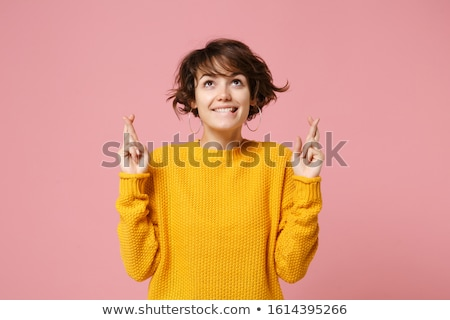 Kobieta stwarzające odizolowany palce gest zdjęcie Zdjęcia stock © deandrobot