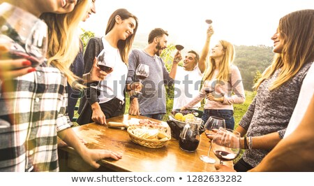 Friends in a fancy restaurant toasting with Italian red wine Stock photo © Kzenon