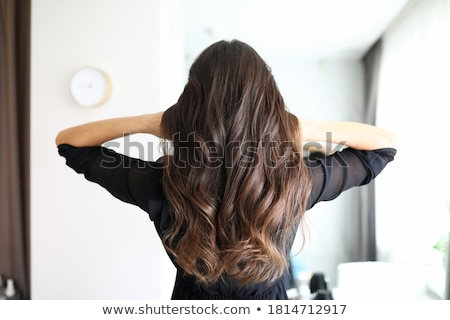 Brunette woman with iron Stock photo © photography33