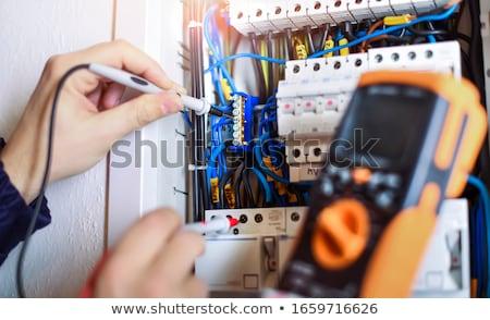 elektricien · leerling · werken · boord · vrouw · huis - stockfoto © photography33