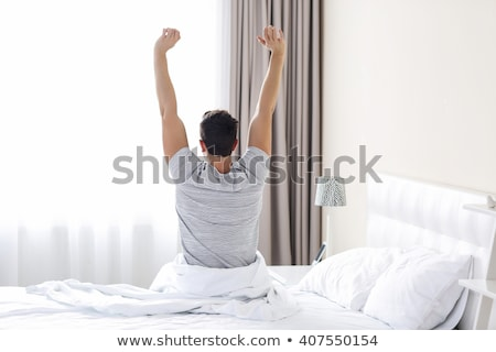 man waking up in his bed Stock photo © photography33