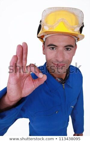 closeup portrait of craftsman making ok sign Stock photo © photography33