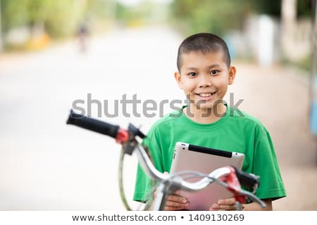 Young boy looking at a laptop stock photo © doupix