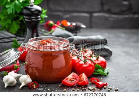 辛い トマトソース ニンニク 唐辛子 スパイス ストックフォト © M-studio