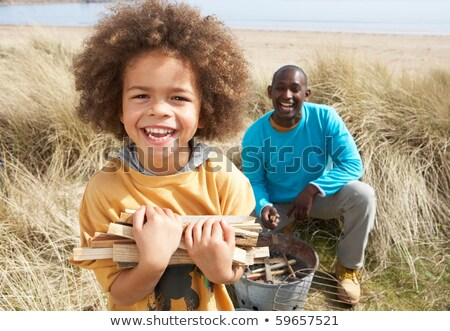 Father And Son Collecting Firewood On Beach Camping Holiday Stock photo © monkey_business