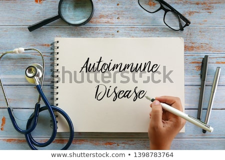 Hand with pen writing Crohns Disease Stock photo © Zerbor
