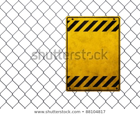 Grunge Yellow Warning Sign on Chainlink Fence of Industrial Ware Stock photo © stevanovicigor