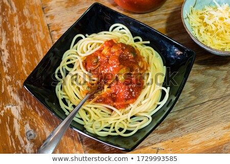 Red hot pepper and spaghetti on old wooden table Stock photo © Valeriy