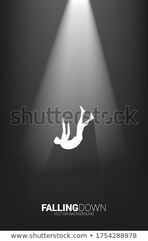 Siluet işadamı düşen örnek kaya siyah Stok fotoğraf © Istanbul2009