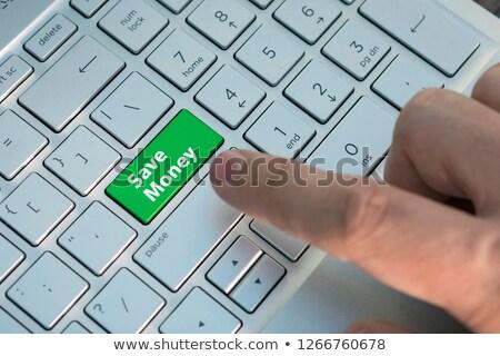 Finger Presses Blue Keyboard Button Deposit. Stock photo © tashatuvango