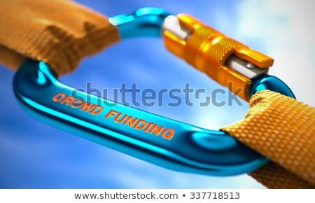Crowd Funding on Blue Carabiner between Orange Ropes. Stock photo © tashatuvango