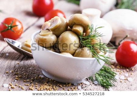 Stock photo: traditional marinated mushrooms
