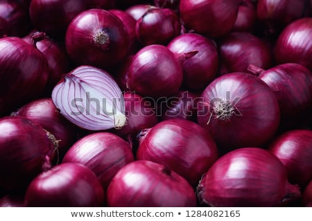 Pile of fresh whole and halved onions Stock photo © photohome