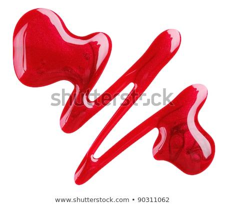 Rojo esmalte de uñas primer plano blanco moda fondo Foto stock © OleksandrO