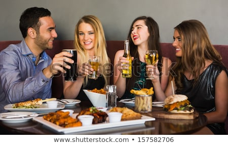 Beautiful long haired woman has dinner with man Stock photo © dash