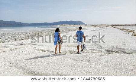 young turkish couple on beach stock photo © lubavnel