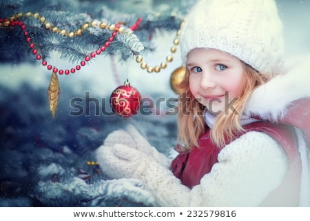 new year frozen ice ball in hand stock photo © shevtsovy
