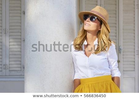 Beautiful blonde woman wearing a hat and sunglasses, enjoying th stock fotó © Yatsenko