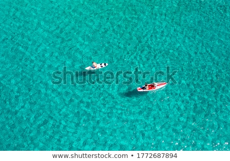 Aerial view of unrecognizable people stand up paddle boarding Stock photo © stevanovicigor